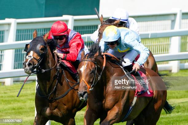 Liam Browne riding Mr Tyrrell win The Ewell Handicap from Old News and Joanna Mason at Sandown Park Racecourse on July 22, 2021 in Esher, England.