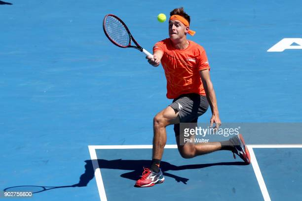 Liam Caruana of Italy plays a forehand during his first round match against Steve Johnson of the USA during day two of the ASB Men's Classic at ASB...