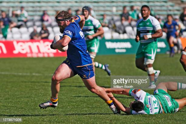 Liam Coltman breaks a tackle on his way to score a try for Otago during the round 2 Mitre 10 Cup match between Manawatu and Otago at Central Energy...