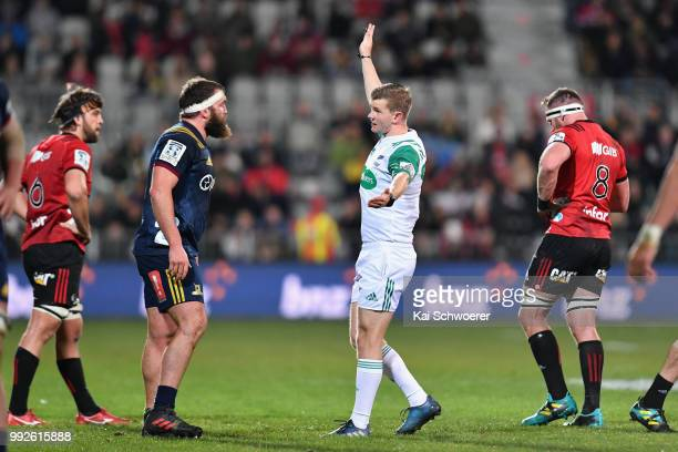 Liam Coltman of the Highlanders and referee Brendon Pickerill react during the round 18 Super Rugby match between the Crusaders and the Highlanders...