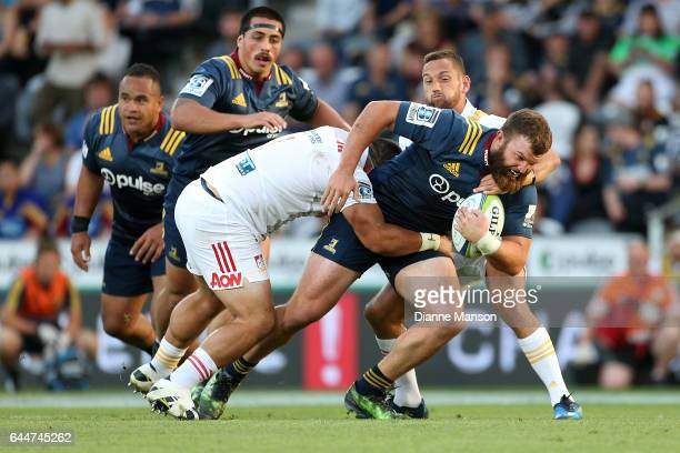 Liam Coltman of the Highlanders on the charge during the round one Super Rugby match between the Highlanders and the Chiefs at Rugby Park Stadium on...