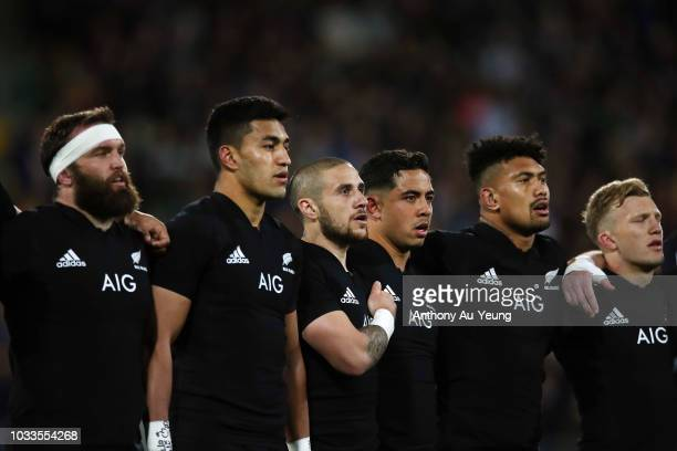 Liam Coltman Rieko Ioane TJ Perenara Anton LienertBrown Ardie Savea and Damian McKenzie of the All Blacks stand for the national anthem during The...