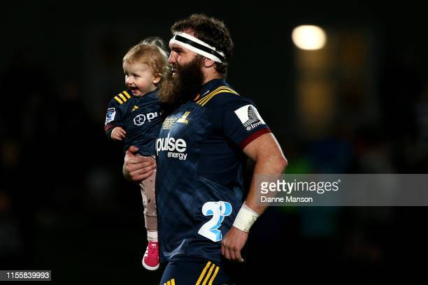 Liam Coltman runs out on field for his 100th Super Rugby match for the Highlanders during the round 18 Super Rugby match between the Highlanders and...