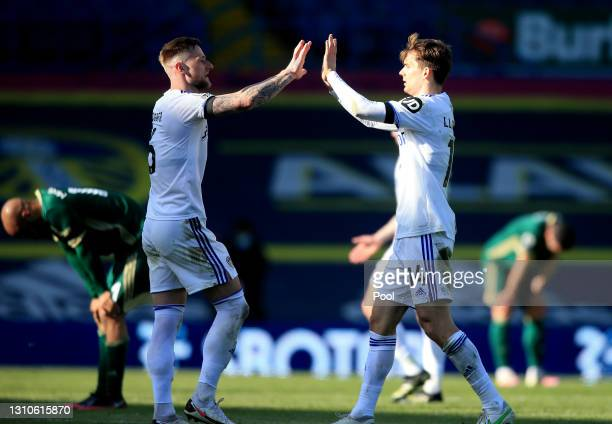Liam Cooper and Diego Llorente of Leeds United celebrate at full-time after the Premier League match between Leeds United and Sheffield United at...
