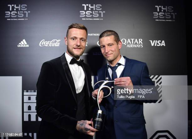 Liam Cooper captain of Leeds United FC and fitness coach Benoit Delaval receive the FIFA Fair Play Award on behalf of Marcelo Bielsa head coach of...