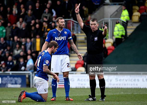 Liam Cooper of Chesterfield is sent off by referee Mark Haywood during the Sky Bet League Two match between Newport County AFC and Chesterfield at...