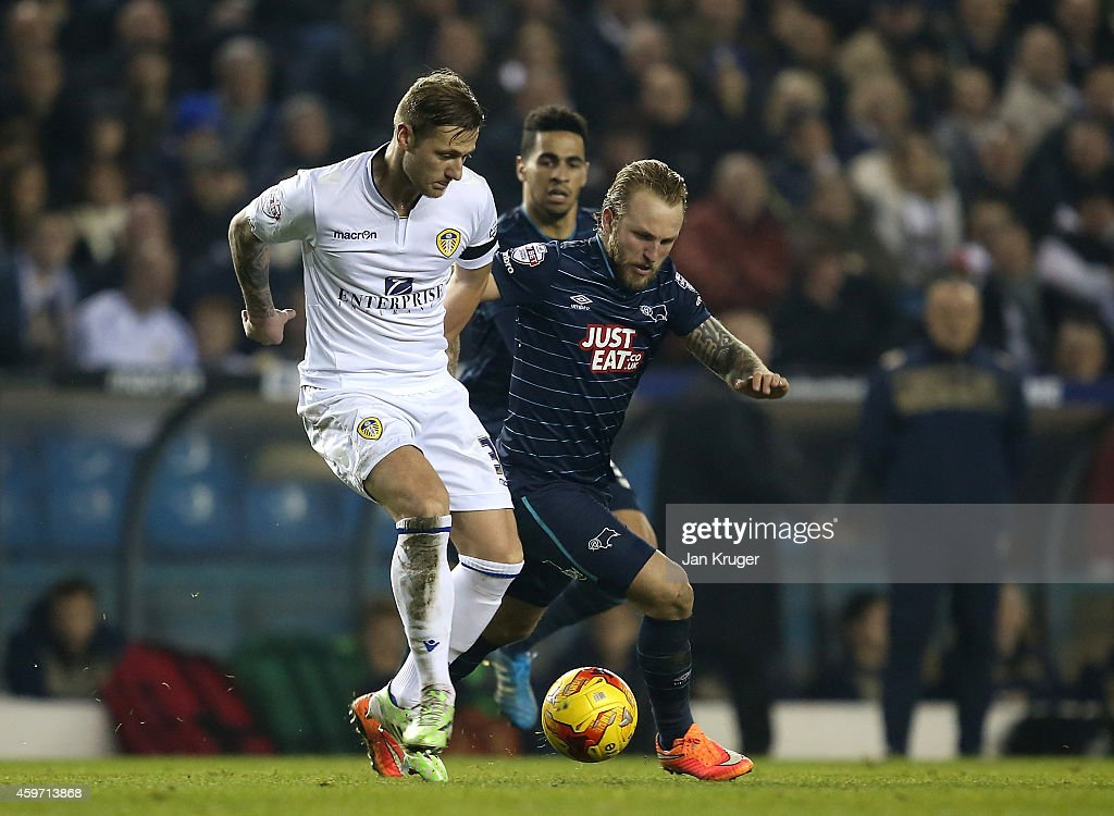 Liam Cooper of Leeds controls the ball from Johnny Russell of Derby County during the Sky Bet Championship match between Leeds United and Derby County at Elland Road on November 29, 2014 in Leeds, England.