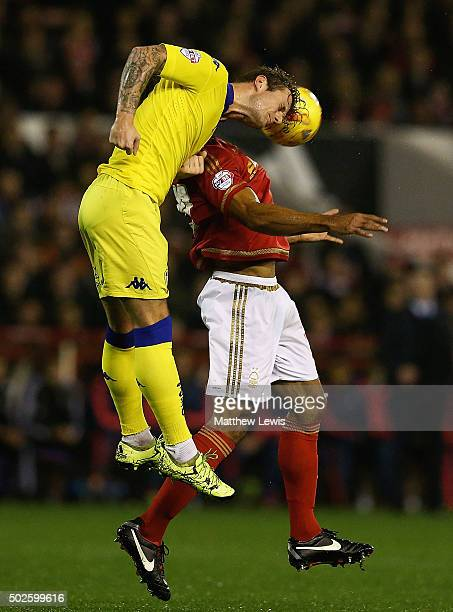 Liam Cooper of Leeds United and Chris O'Grady of Nottingham Forest challenge for the ball during the Sky Bet Championship match between Nottingham...
