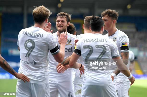 Liam Cooper of Leeds United celebrates his sides first goal, an own goal scored by Michael Sollbauer of Barnsleyduring the Sky Bet Championship match...