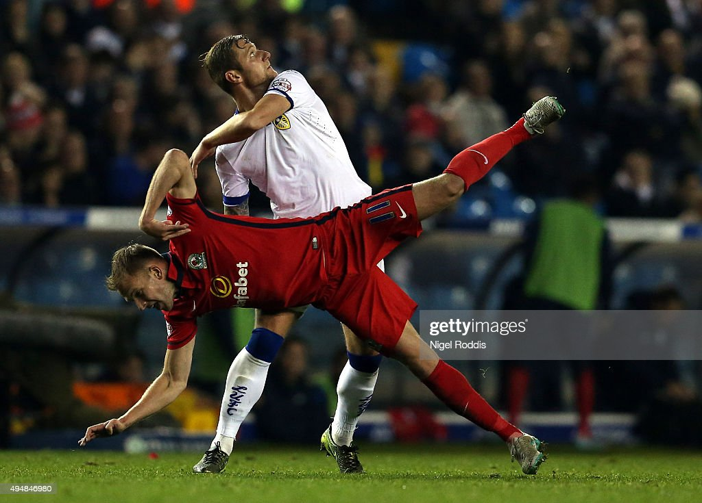 Liam Cooper (top) of Leeds United challenges Jordan Rhodes of Blackburn Rovers during the Sky Bet Championship match between Leeds United and Blackburn Rovers on October 29, 2015 in Leeds, United Kingdom.
