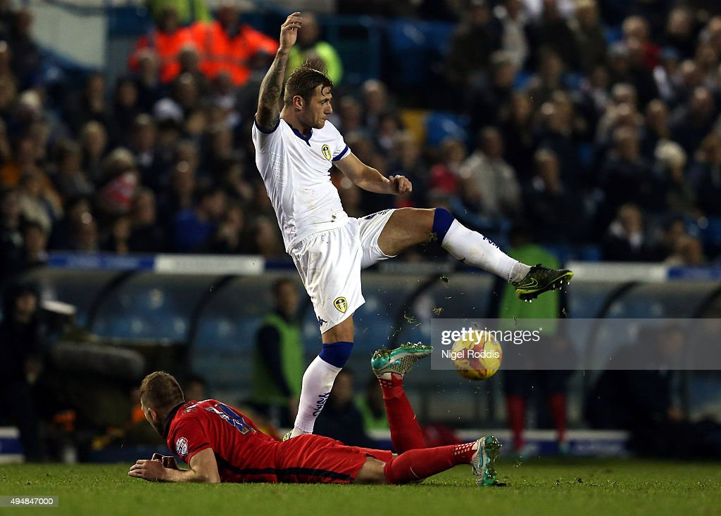 Liam Cooper (R) of Leeds United challenges Jordan Rhodes of Blackburn Rovers during the Sky Bet Championship match between Leeds United and Blackburn Rovers on October 29, 2015 in Leeds, United Kingdom.
