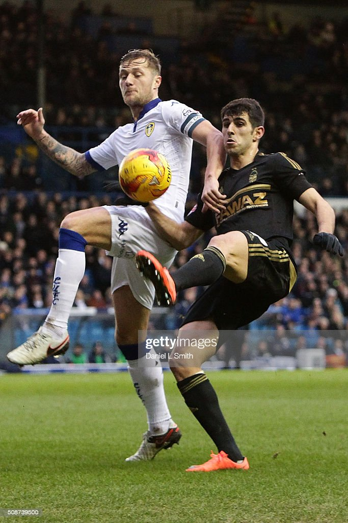 Liam Cooper (C) of Leeds United FC and Nelson Castro Oliveira of Nottingham Forest FC contest for the ball during the Sky Bet Championship match between Leeds United and Nottingham Forest on February 6, 2016 in Leeds, United Kingdom.