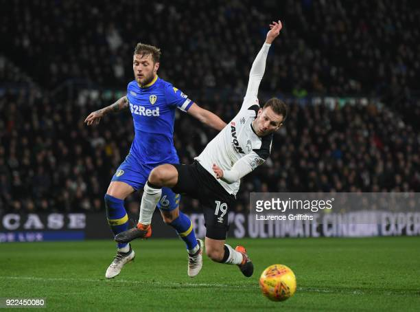 Liam Cooper of Leeds United in action with Andreas Weimann of Derby County during the Sky Bet Championship match between Derby County and Leeds...