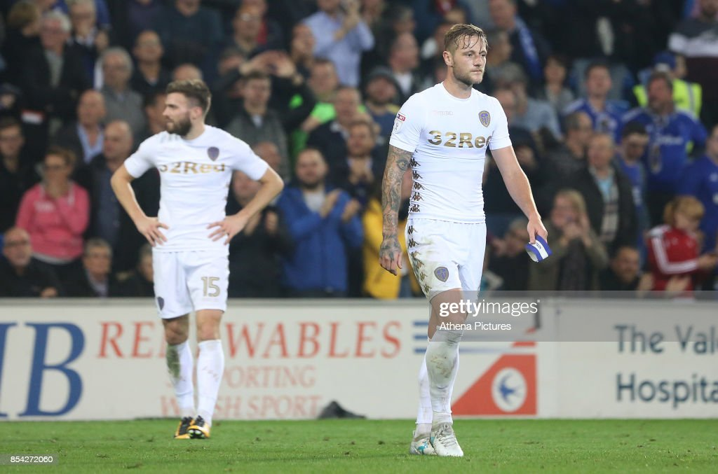 Liam Cooper of Leeds United leaves the field after receiving a red card during the Sky Bet Championship match between Cardiff City and Leeds United at The Cardiff City Stadium on September 26, 2017 in Cardiff, Wales.