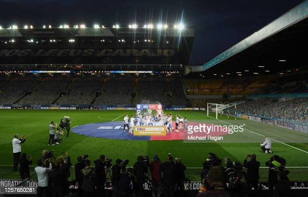 Liam Cooper of Leeds United lifts the trophy in celebration with team mates after the Sky Bet Championship match between Leeds United and Charlton...