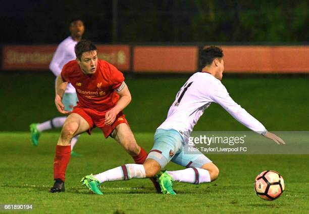 Liam Coyle of Liverpool and Joe Powell of West Ham United in action during the Liverpool v West Ham United U18 Premier League game at The Kirkby...