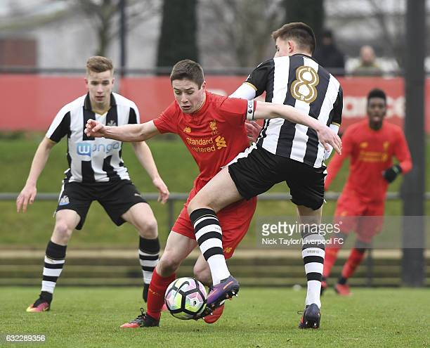 Liam Coyle of Liverpool and Kelland Watts of Newcastle United in action during the Liverpool v Newcastle United U18 Premier League game at The...
