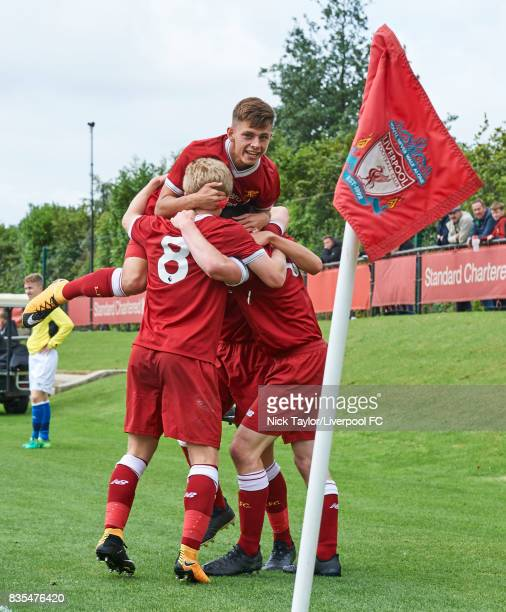 Liam Coyle of Liverpool celebrates his goal with team mates Adam Lewis and Edvard Sandvik Tagseth during the Liverpool v Blackburn Rovers U18 Premier...