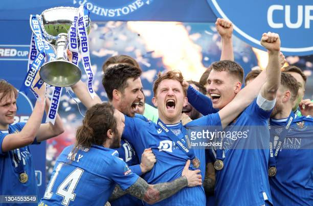 Liam Craig of St Johnstone celebrates with team mates after winning the Betfred Cup Final match between Livingston and St Johnstone at Hampden Park...