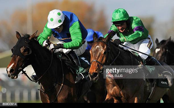 Liam Cresswell riding French horse Mon Mome runs for home to win against Timmy Murphy riding his horse 'Comply or Die' during the Grand National at...