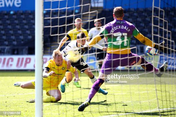 Liam Cullen of Swansea City scores his team's second goal past David Stockdale of Wycombe Wanderers during the Sky Bet Championship match between...