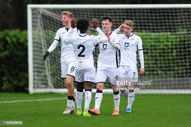 Liam Cullen of Swansea City u23 celebrates scoring his side's third goal during the Premier League 2 Division Two match between Swansea City u23s and...