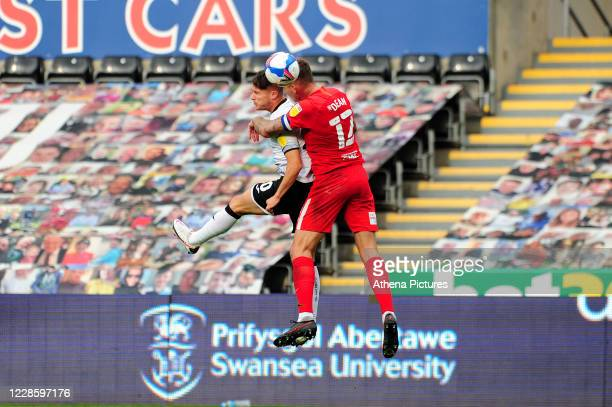 Liam Cullen of Swansea City vies for possession with Harlee Dean of Birmingham City during the Sky Bet Championship match between Swansea City and...
