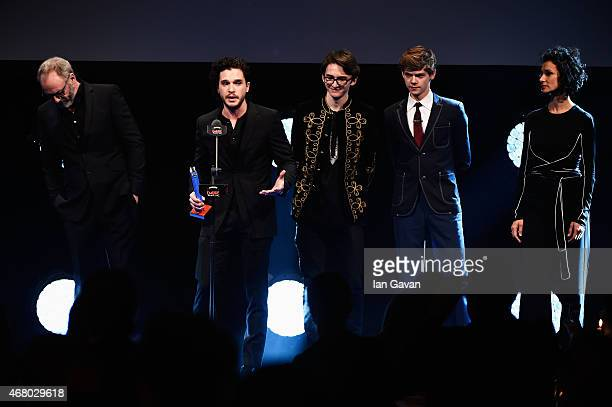 """Liam Cunningham, Kit Harington, Isaac Kempstead and Thomas Brodie-Sangster collect the Empire Hero Award for """"Game of Thrones"""" on stage during the..."""