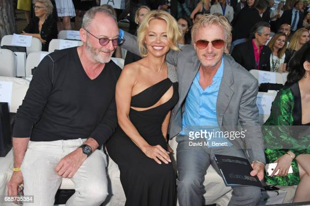 Liam Cunningham Pamela Anderson and Eddie Irvine attend the Amber Lounge Fashion Monaco 2017 at Le Meridien Beach Plaza Hotel on May 26 2017 in...