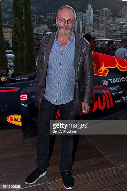 Liam Cunningham poses for photographs at the Red Bull Racing Energy Station at Monte Carlo on May 26 2016 in Monaco