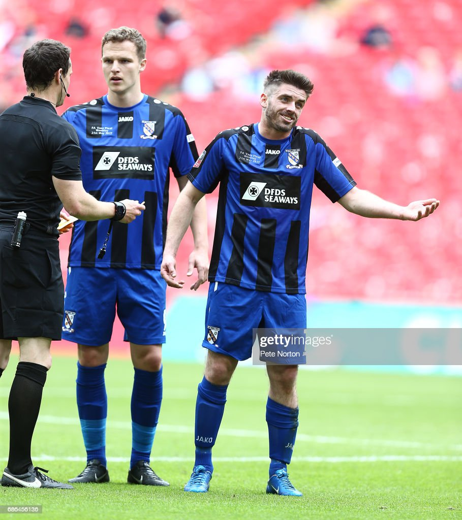 Liam Davis and Marc Cooper of Cleethorpes Town look on prior to referee Darren England showing Davis a yellow card during The Buildbase FA Vase Final between South Shields and Cleethorpes Town at Wembley Stadium on May 21, 2017 in London, England.