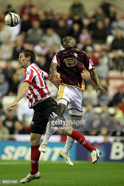 Liam Davis of Northampton Town contests the ball with Daryl Murphy of Sunderland during the Carling Cup Third Round Match between Sunderland and...