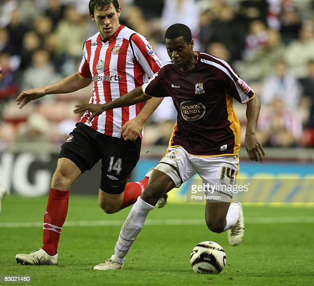 Liam Davis of Northampton Town shields the ball from Daryl Murphy of Sunderland during the Carling Cup Third Round Match between Sunderland and...