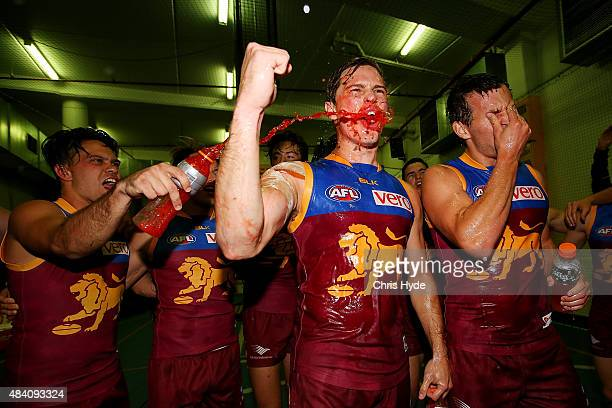Liam Dawson and Billy Evans of the Lions sing the team song after winning the round 20 AFL match between the Brisbane Lions and the Carlton Blues at...