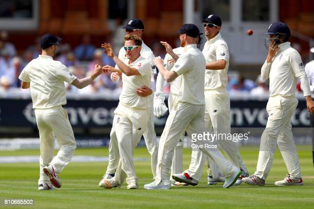 Liam Dawson of England celebrates taking the wicket of Kagiso Rabada of South Africa on day three of the 1st Investec Test match between England and...