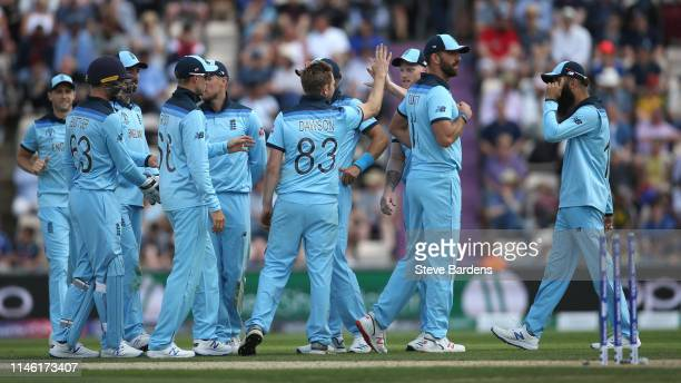 Liam Dawson of England celebrates taking the wicket of Liam Dawson Usman Khawaja of Australia with his team mates during the ICC Cricket World Cup...