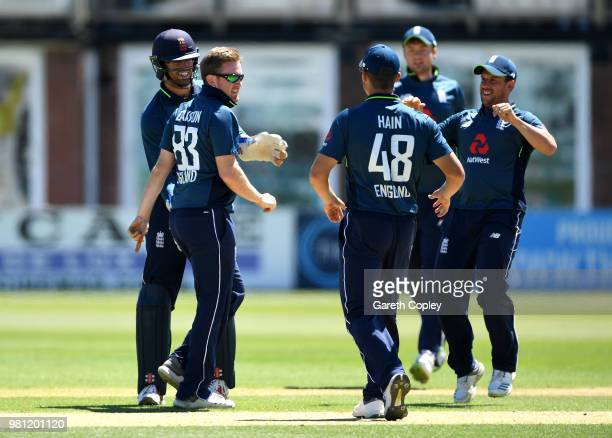 Liam Dawson of England Lions celebrates with teammates after dismissing Vijay Shankar of India A during the TriSeries International match between...