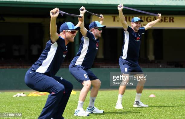 Liam Dawson of England warms up alongside Chris Woakes and Olly Stone during a nets session at P Sara Oval on October 3 2018 in Colombo