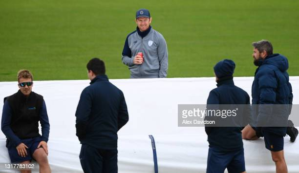 Liam Dawson of Hampshire speaks to the ground staff as play is delayed due to rain on Day One of the LV= Insurance County Championship match between...
