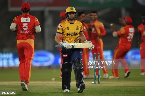 Liam Dawson of Peshawar Zalmi walks back after clean bowled by Mohammad Sami of Islamabad United during the Pakistan Super League final match between...