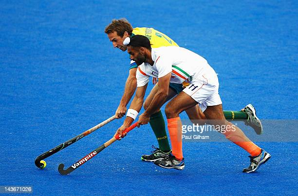 Liam de Young of Australia is tackled by Sarvanjit Singh of India during the Men's preliminary match between Australia and India during the Visa...