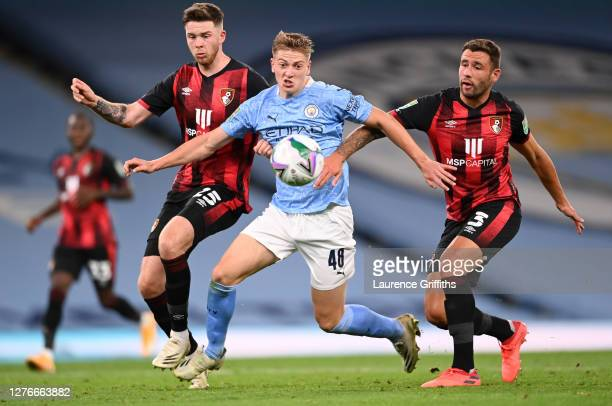 Liam Delap of Manchester City battles for possession with Jack Simpson and Steve Cook of Bournemouth during the Carabao Cup Third Round match between...