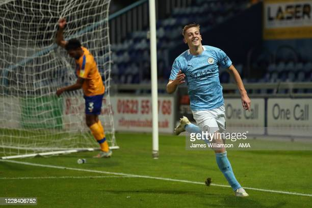 Liam Delap of Manchester City celebrates after scoring a goal to make it 0-3 during the EFL Trophy Northern Section Group E match between Mansfield...