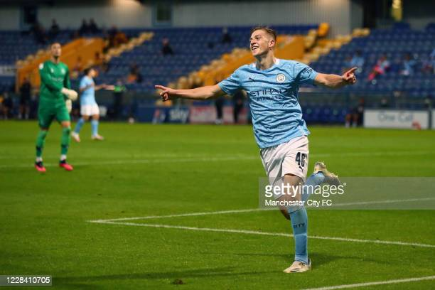 Liam Delap of Manchester City celebrates scoring their 3rd goal during the EFL Trophy match between Mansfield Town and Manchester City U21 at One...