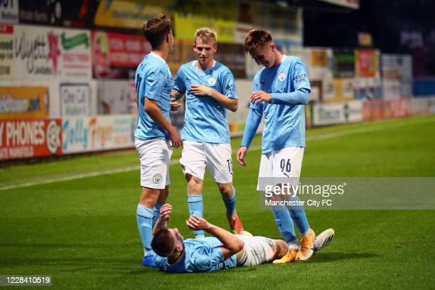 Liam Delap of Manchester City celebrates scoring their 3rd goal with team mates during the EFL Trophy match between Mansfield Town and Manchester...