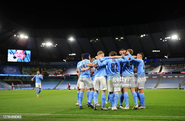 Liam Delap of Manchester City celebrates with teammates after scoring his team's first goal during the Carabao Cup third round match between...