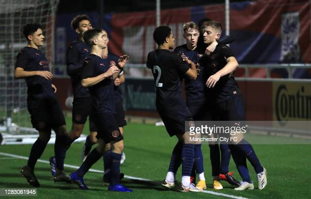 Liam Delap of Manchester City is congratulated on scoring his teams second goal during the FA Youth Cup Semi Final match between Blackburn Rovers and...