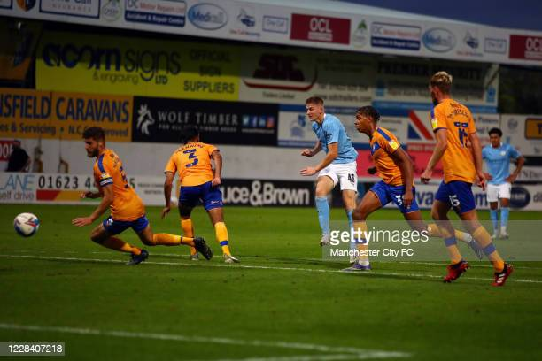 Liam Delap of Manchester City scores their 2nd goal during the EFL Trophy match between Mansfield Town and Manchester City U21 at One Call Stadium on...