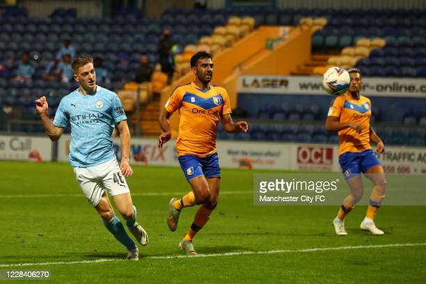 Liam Delap of Manchester City scores their 3rd goal during the EFL Trophy match between Mansfield Town and Manchester City U21 at One Call Stadium on...