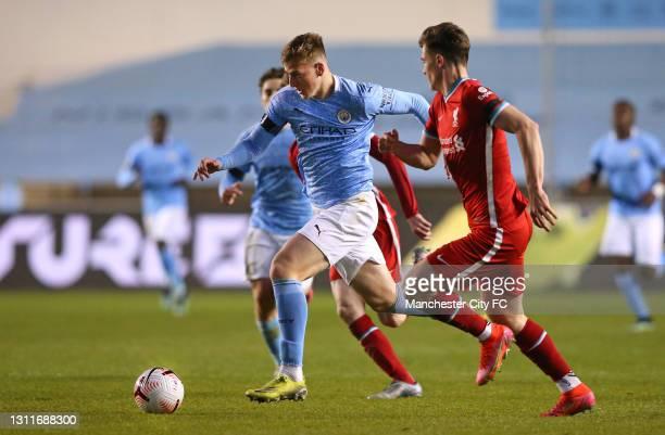 Liam Delap of Manchester City U23 beats Morgan Boyes of Liverpool U23 during the Premier League 2 match between Manchester City and Liverpool at...